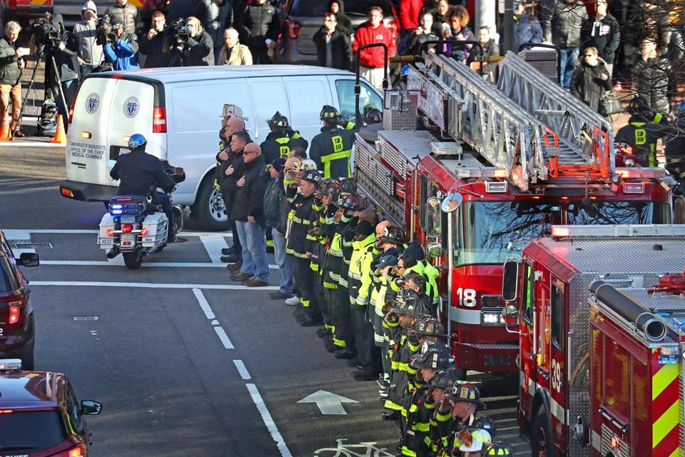 BOSTON, MA - 12/10/2018: First responders from Worcester and across Eastern Massachusetts honored Worcester Firefighter Christopher J. Roy on Monday as a hearse/medical examiner vehicle bearing his body traveled to Boston and the state medical examiner's office. Roy was killed while fighting an five-alarm fire on Lowell Street in Worcester Sunday, the eighth firefighter in that department. David L Ryan/Globe Staff ) SECTION: METRO TOPIC 11worcester